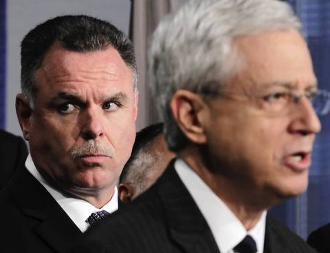 U.S. Attorney Gary Shapiro, right, and Chicago police Superintendent Garry McCarthy join local and federal agencies Sept. 26, 2013, in announcing charges against members of the Hobos street gang.