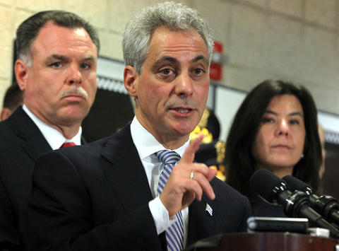 Mayor Rahm Emanuel, flanked by Chicago police Superintendent Garry McCarthy and State's Attorney Anita Alvarez, announces gun safety legislation on Feb. 11, 2013, to increase minimum sentencing for the most serious gun crimes and require offenders to serve at least 85 percent of their sentence.