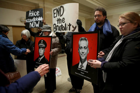 Protesters on Feb. 18, 2015, put ashes on posters of Mayor Rahm Emanuel and police Superintendent Garry McCarthy to represent repentance, to demand reform in the Chicago Police Department and to seek an end to police brutality against citizens.