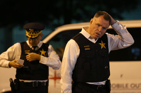 Chicago police Superintendent Garry McCarthy walks toward the media outside the emergency room at Stroger Hospital on Oct. 7, 2014, after an officer was shot earlier in the Englewood neighborhood.