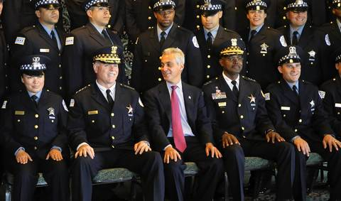Chicago police Superintendent Garry McCarthy, second from left, joins Mayor Rahm Emanuel and a new graduating class for a group photo before graduation June 11, 2014, at Navy Pier.