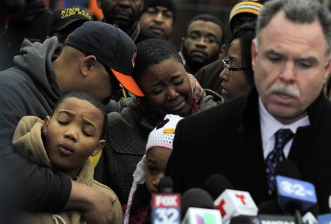 Nathaniel Pendleton Jr., from left, brother of slain teen Hadiya Pendleton, is embraced by his father, Nathaniel Pendleton, as his mother, Cleopatra Cowley-Pendleton, weeps during a Jan. 30, 2013, news conference with police Superintendent Garry McCarthy at Harsh Park.
