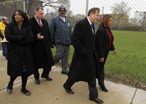 Felicia Davis, from left, of the mayor's office, police Superintendent Garry McCarthy, Building Commissioner Michael Merchant, CTA President Forrest Claypool and Chicago Public Schools CEO Barbara Byrd-Bennett walk from Ross Elementary to Dulles Elementary on May 3, 2013, to experience the walk students have each day.