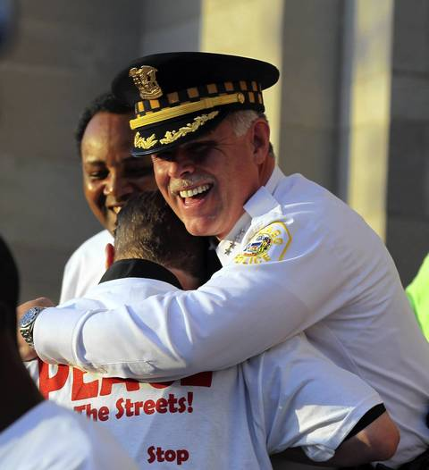 Chicago police Superintendent Garry McCarthy hugs the Rev. Michael Pfleger on June 15, 2012, during a peace rally outside St. Sabina Church.