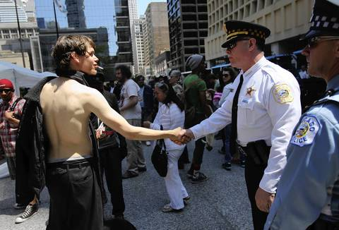 "Chicago police Superintendent Garry McCarthy greets Occupy protester ""Romania,"" of Scranton, Pa., at Daley Plaza during demonstrations May 18, 2012, over the NATO summit."