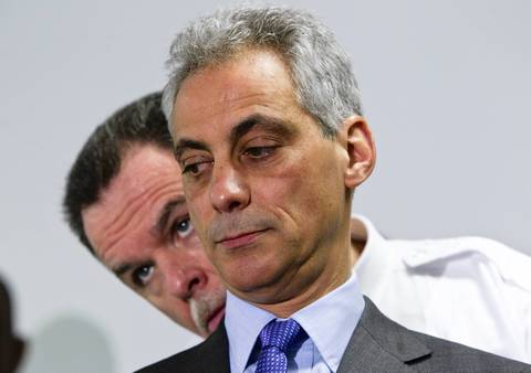 Mayor Rahm Emanuel listens to police Superintendent Garry McCarthy on May 15, 2012, before making an announcement about a new public safety strategy.