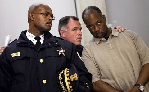 Deputy Superintendent Alfonza Wysinger, from left, Superintendent Garry McCarthy and Cmdr. Walter Green talk before a news conference Dec. 30, 2011, about fallen Officer Clifton Lewis, who was fatally shot the night before while attempting to stop an armed robbery.