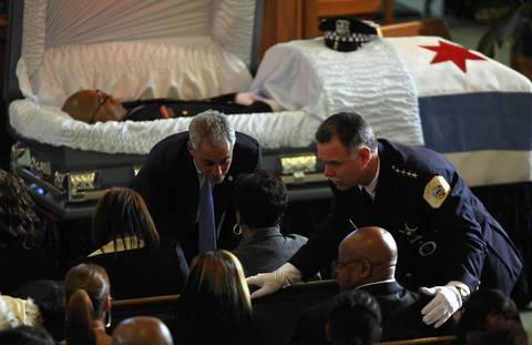 Mayor Rahm Emanuel and police Superintendent Garry McCarthy greet the family of police Officer Clifton Lewis during services Jan. 5, 2012, at Missionary Baptist Church. Lewis was killed in the line of duty.