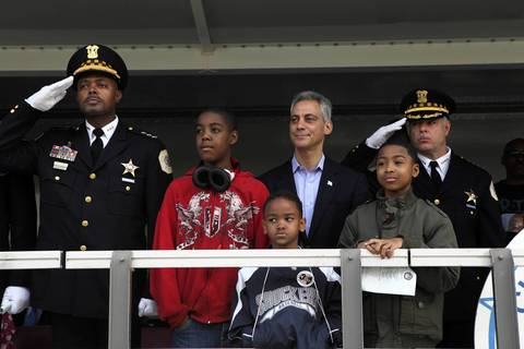 Deputy Superintendent Al Wysinger, left, Mayor Rahm Emanuel and Superintendent Garry McCarthy stand with family members of slain Officers Clifton Lewis and Paul Nauden during the St. Jude Police League parade and ceremony May 6, 2012.