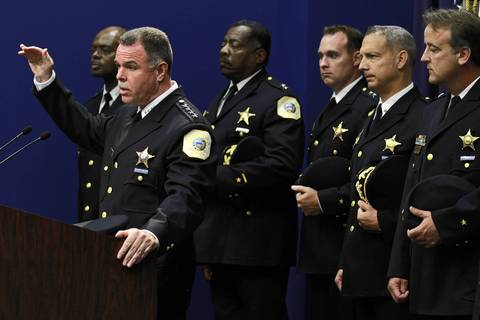 Chicago police Superintendent Garry McCarthy, left, announces a reorganization and restructuring of the department's command positions during a news conference Aug. 8, 2011, at police headquarters. The changes, which simplify the command structure, are expected to save the department more than $1 million.