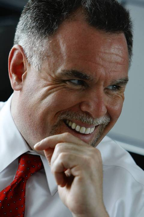 Chicago police Superintendent Garry McCarthy laughs during an interview May 30, 2011.