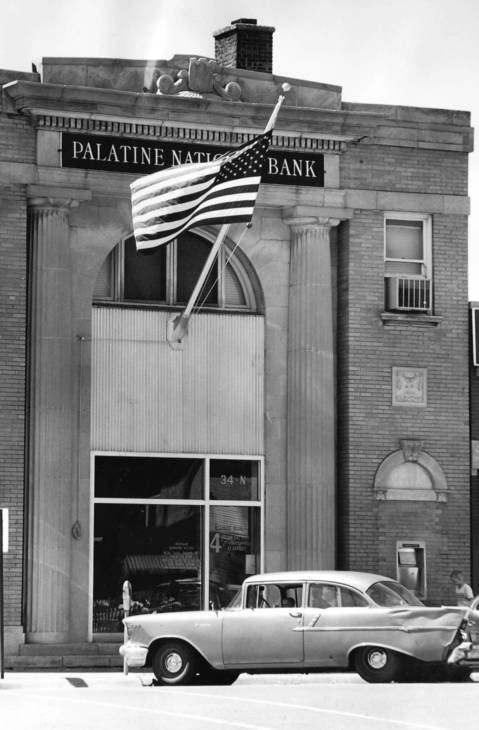 July 1962: Old Glory flies outside Palatine National Bank.