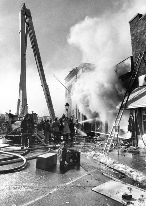 February 1973: Firefighters fight a blaze at the Ben Franklin Variety Store in downtown Palatine.