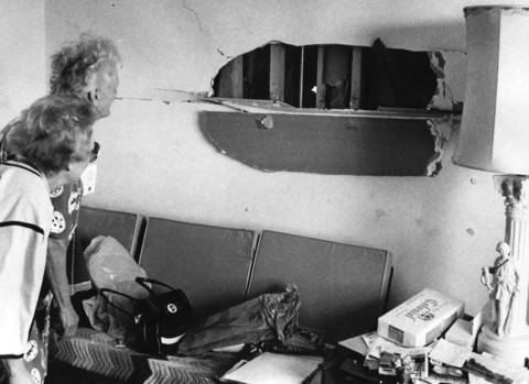 April 1976: Women look through a hole in the wall caused by a natural gas explosion at a Palatine apartment complex.