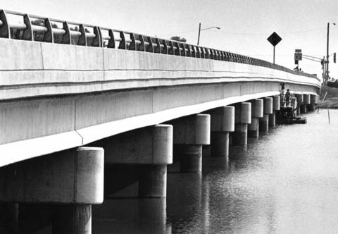 October 1983: Construction workers put the finishing touches on the Lake-Cook Bridge near Palatine.