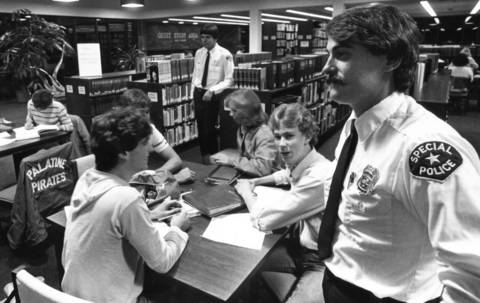 November 1983: A security guard patrols the Palatine Public Library as part of an effort to reduce noise.