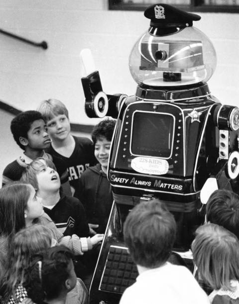 "January 1987: Sam (""Safety Always Matters"") enthralls students at Lincoln School in Palatine. The robot is part of a safety outreach effort by the Palatine Police Department."