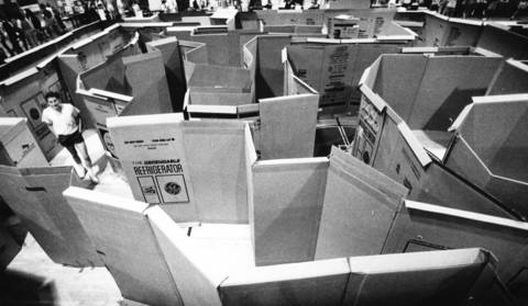 June 1987: An explorer works his way through a maze of refrigerator boxes at a psychology fair in the Fremd High School gym in Palatine.