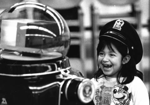 January 1988: Lizet Mendoza, 7, of Palatine, wears Sam the Robot's hat as she answers his questions in Palatine.