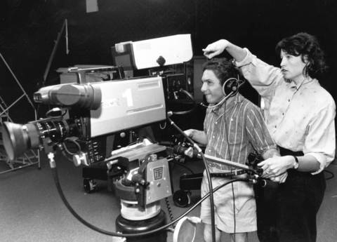 June 1990: Camera operator Steve Wynn of Little City zooms in for a shot while listening to directions from Maggie Lee, media arts coordinator, at the Palatine Community Center.