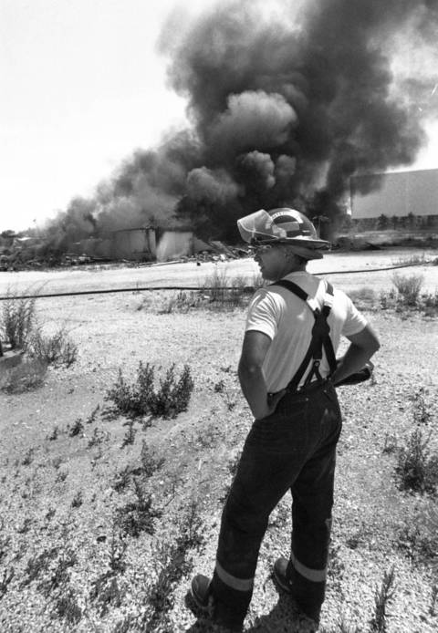 August 1988: A firefighter watches flames engulf the abandoned Rt. 53 Drive-In at Hicks and Rand roads in Palatine.