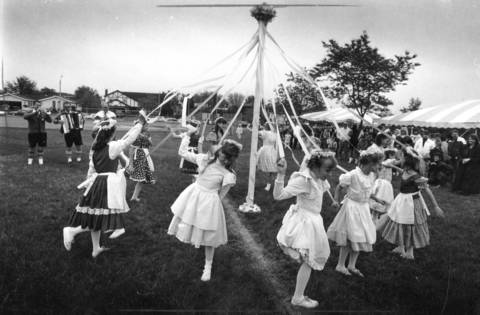 April 1991: A group of young girls circles the maypole during Palatine's 125th anniversary celebrations.