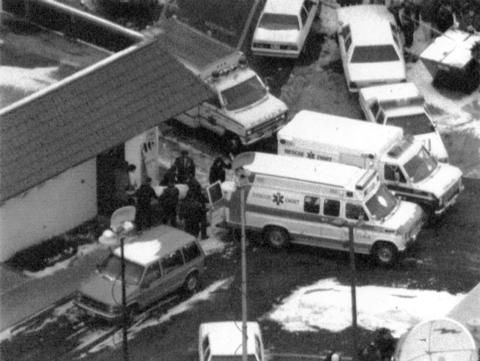 January 1993: Police and emergency officials remove one of seven people killed at a Brown's Chicken in Palatine.