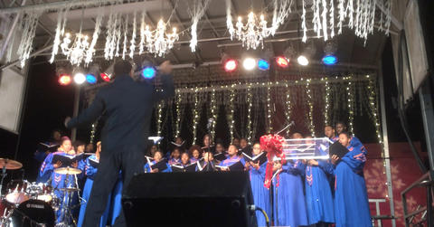 The Morgan State University Choir sings during the Washington Monument lighting ceremony at Mount Vernon Place.