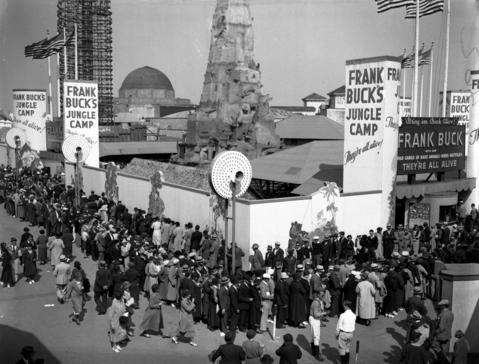 """Visitors wait in a long line to get into the Frank Buck Jungle Camp exhibit on Constitution Day on Sept. 17, 1934. The Tribune reported that """"a throng of 356,673 people, by far the greatest crowd at the fair this year,"""" came out for the festivities. """"Throughout the afternoon and evening they came, until the avenues on the grounds were solid masses of humanity."""""""