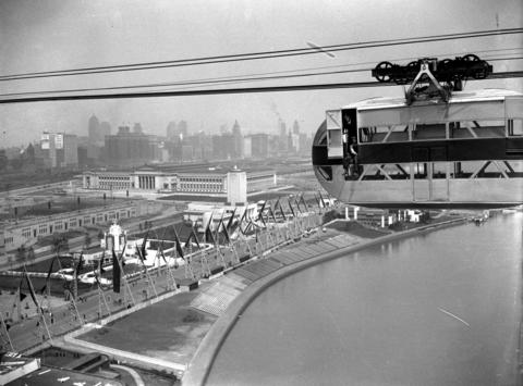 """The Sky Ride soared over the lagoon between Northerly Island and the lakefront in 1933. One Tribune reporter wrote of the ride: """"You get off the elevator and, when your turn comes, enter either the upper or lower half of a large steel capsule set with windows. They seal you in and start you off, bumping slightly, for a ride across the lagoon to the tower on the other side. It costs you 40 cents a head to get this sky view of the Fair, and another forty to go to the top of each tower. These are about as high as the Woolworth building, being 625 feet up, and the view, particularly at night, is gorgeous. A clear day in the towers gives you an idea of the vastness of the spreading city below you. The greatest city in America it will be one day."""""""