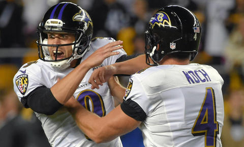 Ravens punter Sam Koch (4) congratulates kicker Justin Tucker, who celebrates kicking the game-winning field goal to beat the Pittsburgh Steelers during overtime at Heinz Field in Pittsburgh.