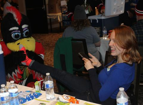 Rebecca McDonald of Glen Ellyn gets a footrub from Chicago Blackhawk mascot Tommy Hawk following her blood donation at the annual LifeSource Holiday blood drive with the Blackhawks Dec. 19 at The Westin O'Hare in Rosemont.