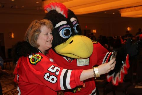 Kellie House of Buffalo Grove takes a quick selfie with Chicago Blackhawk mascot Tommy Hawk during the annual LifeSource Holiday Blood Drive with the Blackhawks December 19 at The Westin O'Hare in Rosemont.