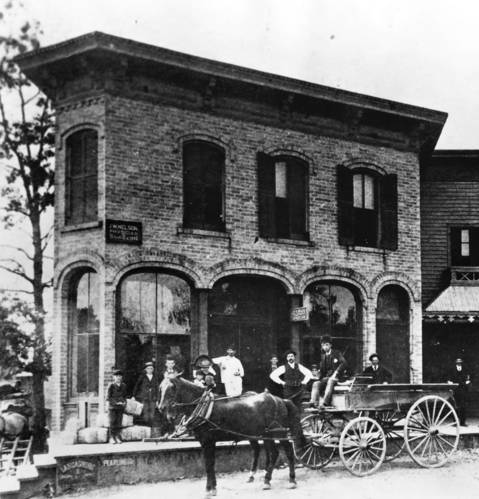 Residents pose for a photo outside the Gage & Meyer store at Elm Street and Green Bay Road in Winnetka. The building, which had the town's first telephone, burned down in 1917. The Winnetka Trust & Savings Bank now stands at the site.
