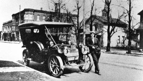 Omer Porter poses by his 1910 Packard in an undated photo.