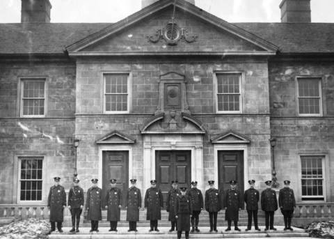 Winnetka police officers pose for a photo outside the new administration building at Linden Avenue and Elm Street in January 1926.