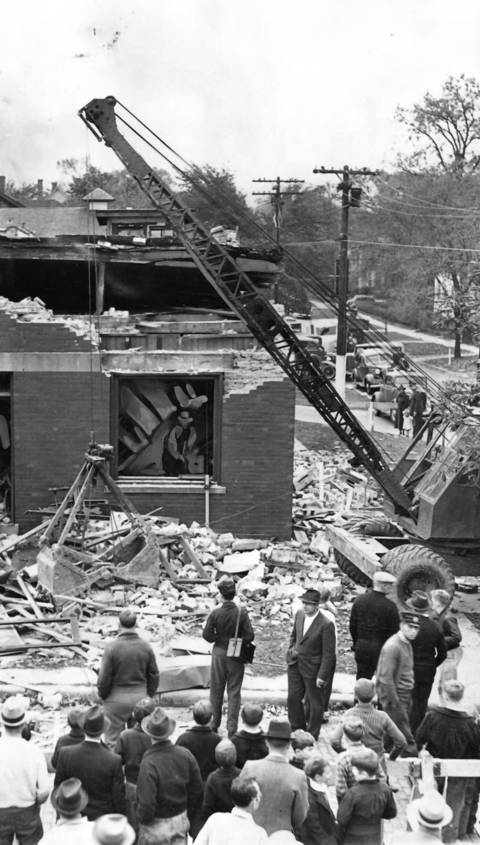 A crowd examines the ruins of the Winnetka-Libertyville Dairy Company building in Winnetka a day after it was gutted by an explosion in October 1937. One person was killed.