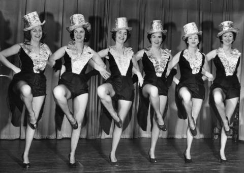 Members of a dance line rehearse for an upcoming show at the Winnetka Woman's Club in 1954.