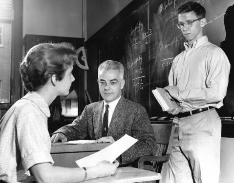 Ann Beckett, head of the New Trier Township High School's Honor Committee, and Stephen Doughty, right, Student Council president, talk about a student who had cheated on an exam with algebra teacher Norman Ude in 1959.