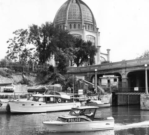 Winnetka's police boat cruises out of Wilmette Harbor to patrol the village's shoreline in 1964.