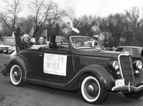 Members of the Winnetka League of Women Voters participate in a parade in 1966 while riding in a car that dates back to the 1920s.