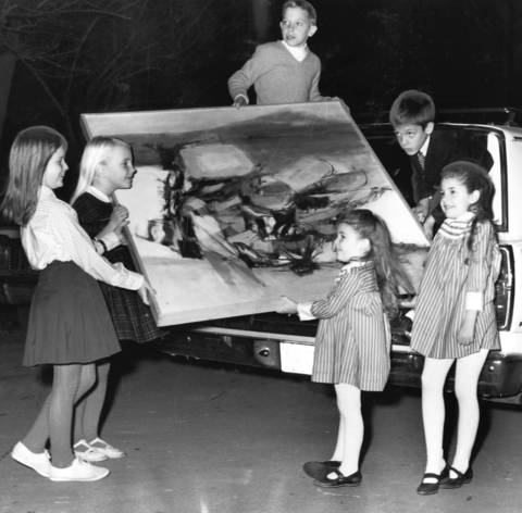 Children help collect art for the Winnetka Art Rental Library in 1966 before it opened in The Skokie School in Winnetka.