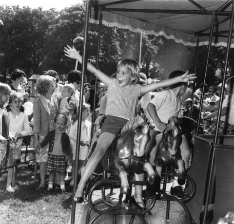 """Look mom, no hands!"" cries Lisa Malmquist, 5, as she rides the merry-go-round in Winnetka in 1967."