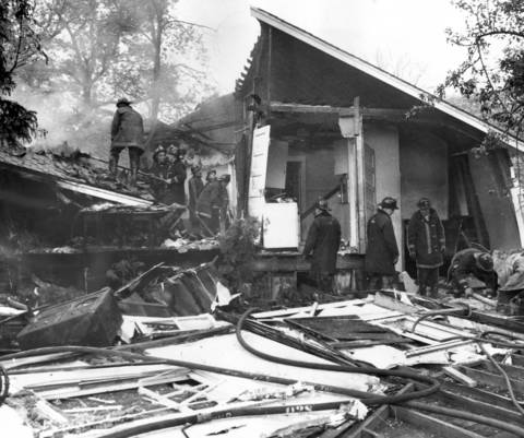 Firefighters stand outside the ruins of a Winnetka house after it was destroyed by a fire and an explosion in May 1968. One person was killed and four were injured.