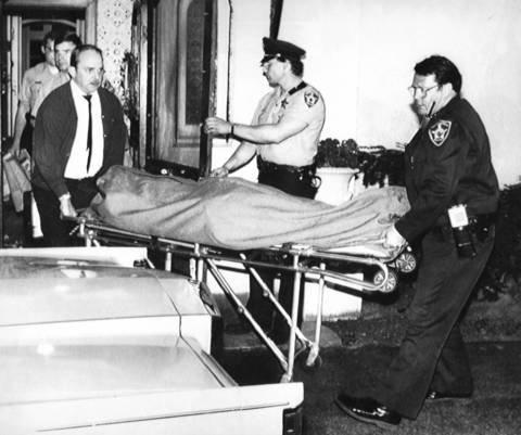 The body of Laurie Dann is removed from a home in Winnetka in 1988. Earlier, Dann shot several students and killed Nicky Corwin, 8, at Hubbard Woods Elementary School before escaping. Dann killed herself with a gunshot to the head.