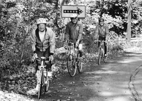 Ken Light, Bob Williams and Ted Sanders ride their bicycles along Sheridan Road in 1987.
