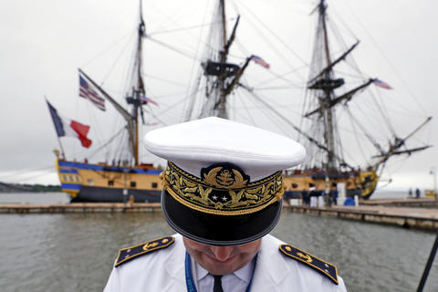 Rear Admiral Heivé Blejean of the French Navy stands on the pier after the French tall ship Hermione docks at Yorktown Friday morning.