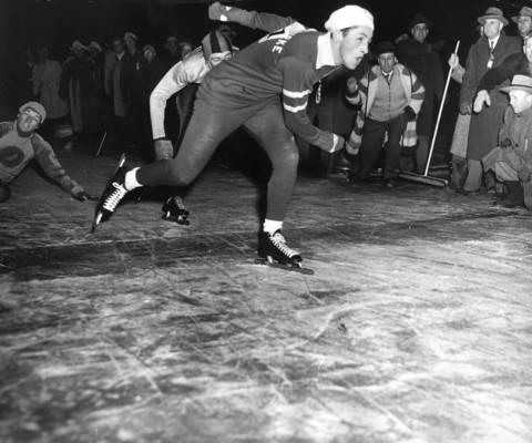 Chuck Burke, Catholic Youth Organization speedskater, wins a 2-mile race in 1950.