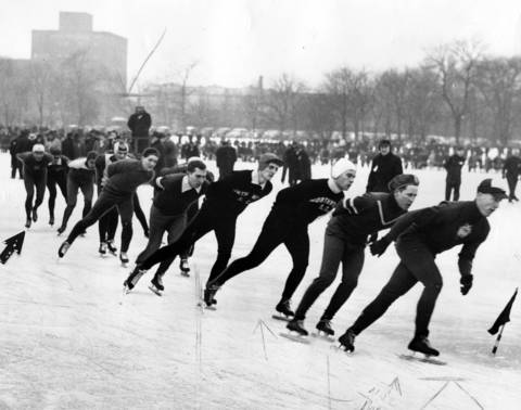 Speedskaters continue through the halfway mark of the men's two-mile Silver Skates title race at Garfield Park on Jan. 17, 1943. At the rear is Del Lamb of Milwaukee (see arrow), who moved up later for an easy victory. The four leaders at this point were, right to left, James De Swarte, Bill Carnduff, Al Perry and Chuck Edwards, all unplaced at the finish.