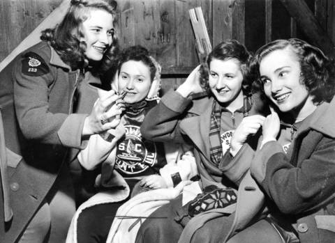 Four Minnesota girls take time to primp while waiting for their events on Jan. 22, 1947, at the Silver Skates meet on the Waveland rink. They are, from left, Lois Bell, Janice Christopherson, Gerry Scott, and Marilyn Hemsey. Janice represented Midway Skating Club of St. Paul, while the other three carried colors of Powderhorn Skating Club of Minneapolis.